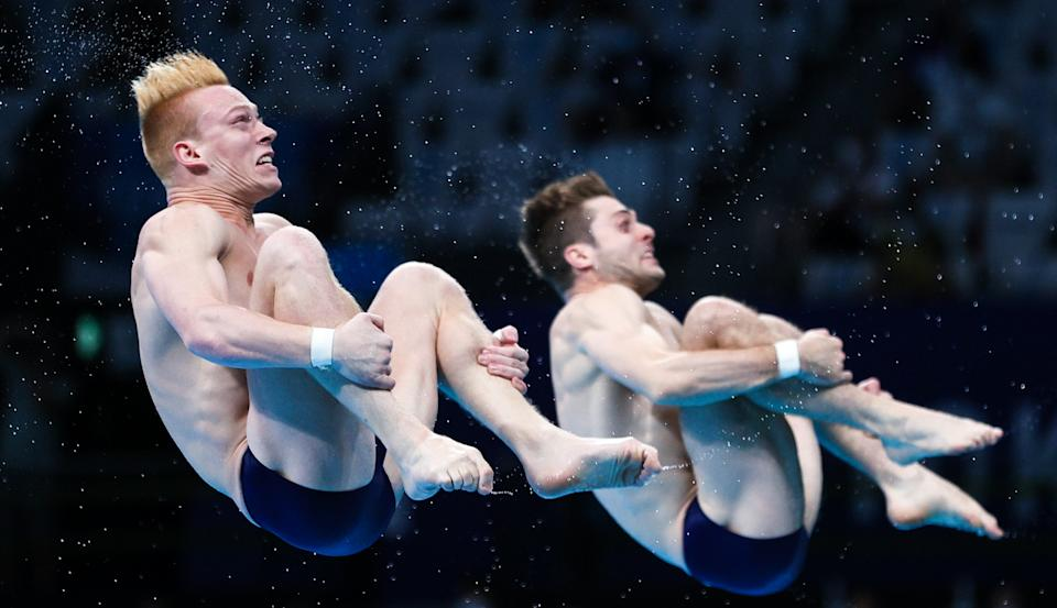 U.S. divers Andrew Capobianco (left) and Michael Hixon won the silver medal in men's 3-meter synchronized springboard diving in Tokyo. (Photo by Sergei Bobylev\TASS via Getty Images)