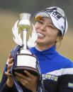 South Korea's Mi Jung Hur poses as she celebrates with the trophy after winning the Ladies Scottish Open at The Renaissance Club in North Berwick, Scotland, Sunday Aug. 11, 2019. (Kenny Smith/PA via AP)