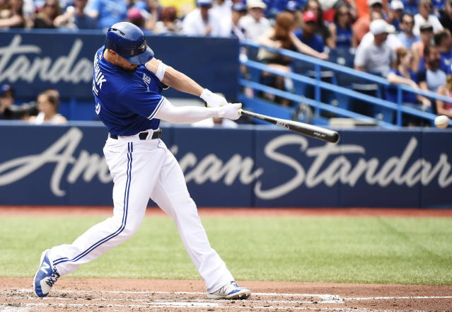 Toronto Blue Jays right fielder Randal Grichuk hits an RBI double against the Atlanta Braves during the fourth inning of a baseball game in Toronto, Wednesday, June 20, 2018. (Nathan Denette/The Canadian Press via AP)