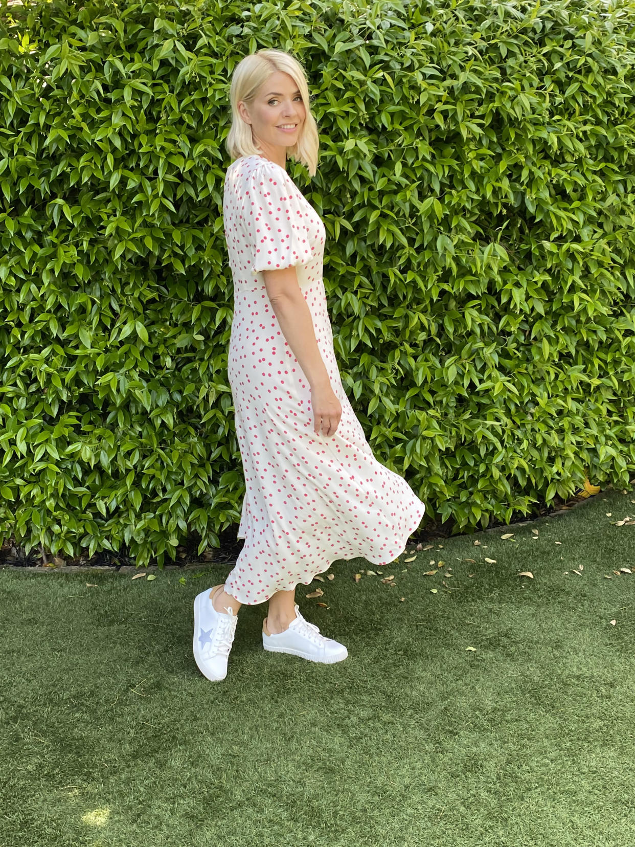 Holly Willoughby pairs her M&S Polka Printed Midi Dress with star print trainers for a more casual look.  (Marks and Spencer)