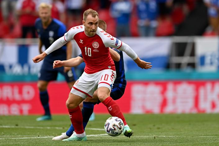 Denmark's Christian Eriksen controls the ball during the Euro 2020 soccer championship group game against Finland. He collapsed during the first half and taken to the hospital.