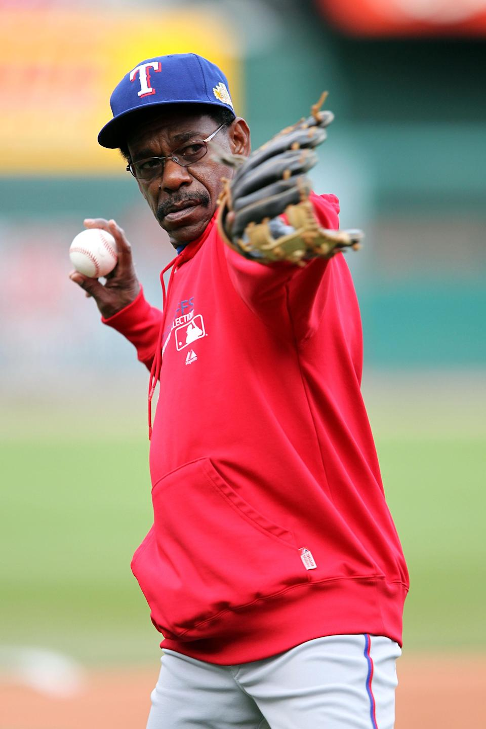 ST LOUIS, MO - OCTOBER 20: Manager Ron Washington of the Texas Rangers throws a ball on the field during practice prior to Game Two of the MLB World Series against the St. Louis Cardinals at Busch Stadium on October 20, 2011 in St Louis, Missouri. (Photo by Jamie Squire/Getty Images)