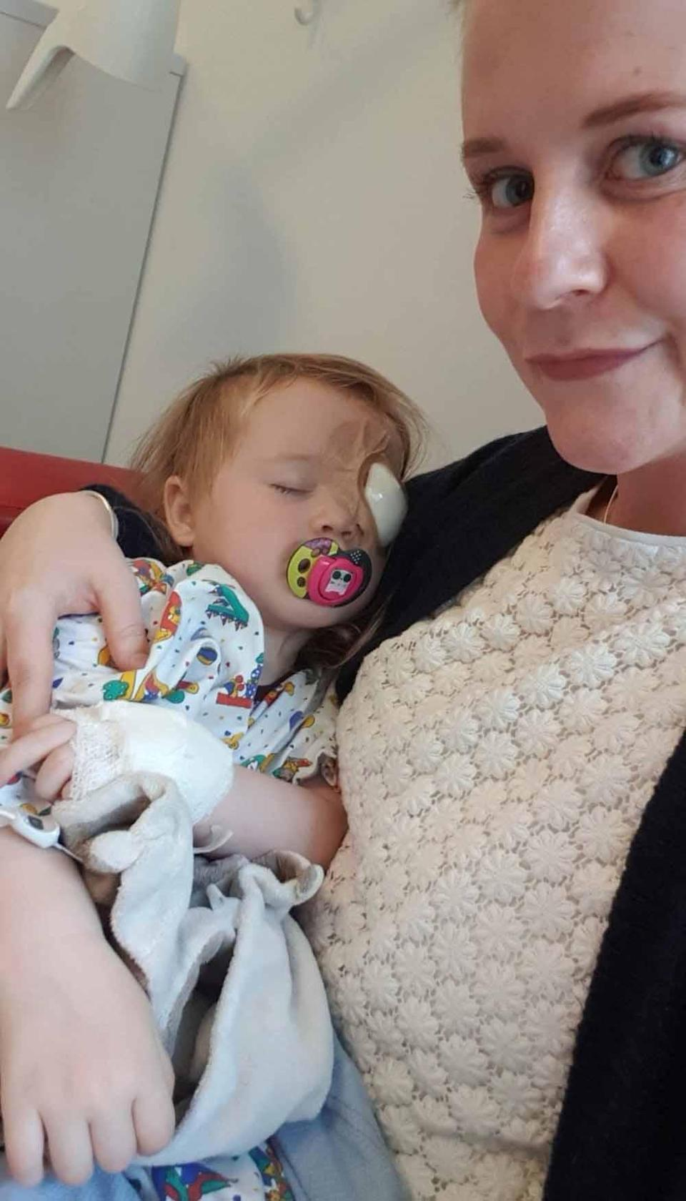 Evie with a radioactive plaque fitted to her eye. PA REAL LIFE COLLECT