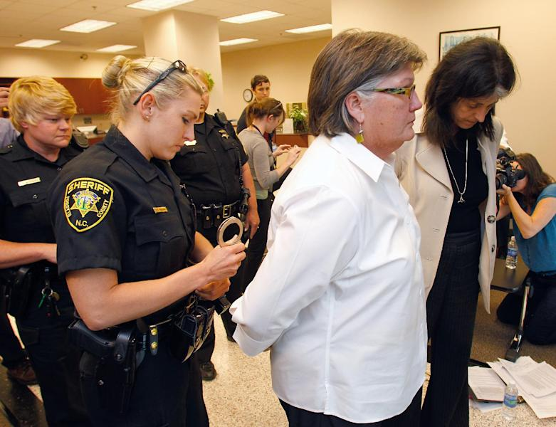 Forsyth County sheriff's deputies arrest Mary Lee Bradford of Winston-Salem and Mary Jamis of Mocksville after they refused to leave at the Forsyth County Register of Deeds office in Winston-Salem, N.C., Thursday, May 10, 2012. The two women staged a sit in at the office after some couples were refused a marriage license because they were gay or lesbian. (AP Photo/Bob Leverone)