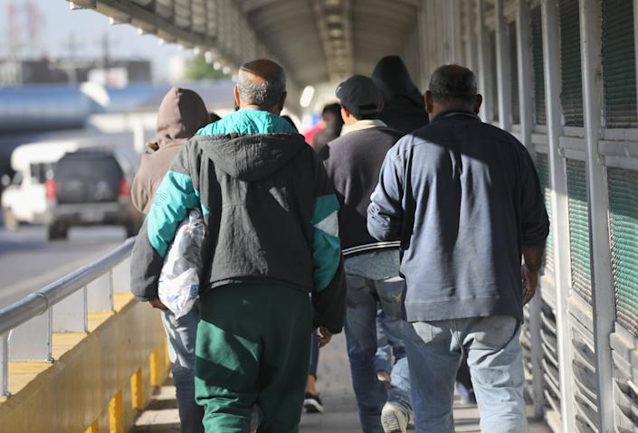 Immigrants are deported across an international bridge into Mexico on March 14, 2017 from Hidalgo, Texas.