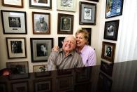 Actor Mickey Rooney and his wife Jan pose for a picture during an interview with Reuters at his home in Westlake Village, California in this February 14, 2007 file photo. Rooney, the pint-sized screen dynamo of the 1930s and 1940s best known for his boy-next-door role in the Andy Hardy movies, died on April 6, 2014 at 93, the TMZ celebrity website reported. It did not give a cause of death and a spokesman was not immediately available for comment. REUTERS/Mario Anzuoni/Files (UNITED STATES - Tags: ENTERTAINMENT OBITUARY)