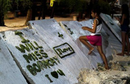 A girl scribbles on a wall two days before the temporary closure of the holiday island Boracay, in the Philippines April 24, 2018. REUTERS/Erik De Castro