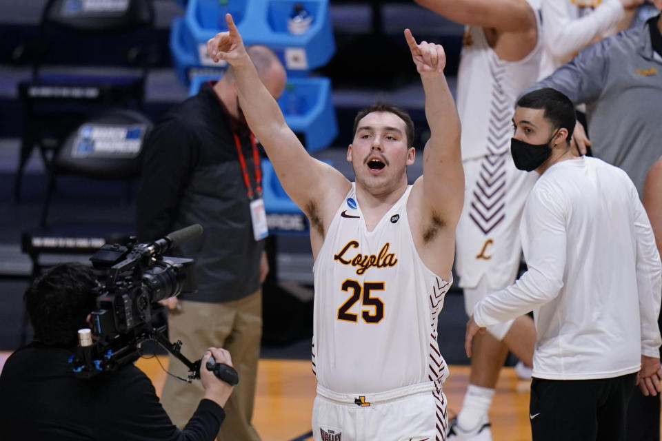 Loyola Chicago center Cameron Krutwig (25) celebrates after defeating Georgia Tech 71-60 in a first-round game in the NCAA men's college basketball tournament at Hinkle Fieldhouse, Indianapolis, Friday, March 19, 2021. (AP Photo/AJ Mast)