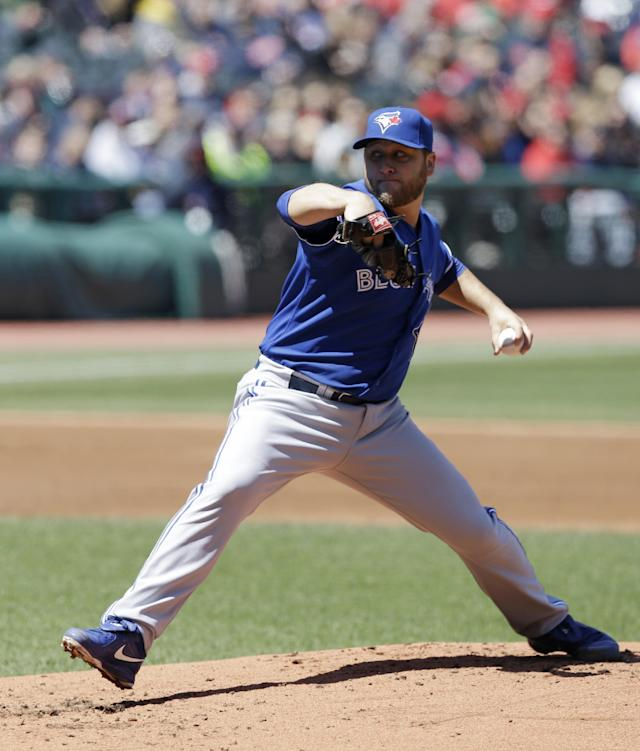 Toronto Blue Jays starting pitcher Mark Buehrle delivers in the first inning of a baseball game against the Cleveland Indians, Saturday, April 19, 2014, in Cleveland. (AP Photo/Tony Dejak)