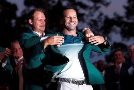 FILE PHOTO: Sergio Garcia of Spain smiles as he is presented the green jacket by last year's champion, Danny Willett of England, after winning the 2017 Masters golf tournament in a playoff at Augusta National Golf Club in Augusta, Georgia, U.S., April 9, 2017. REUTERS/Mike Segar/File Photo