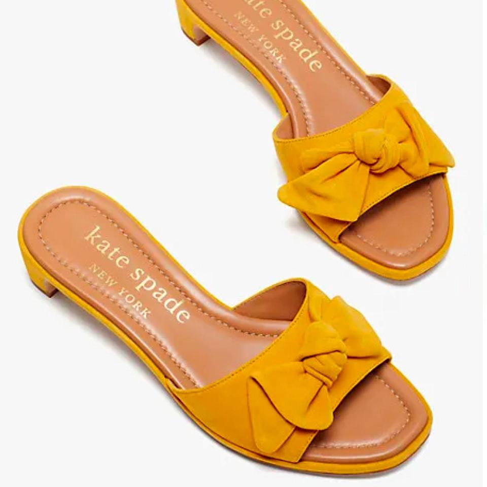 """Think outside of the wedding flats box (no shade to ballet flats) with these suede slides, which are perfect for a garden wedding—you won't have to worry about sinking into the grass. These come in three cheerful color options. $188, Nordstrom. <a href=""""https://www.nordstrom.com/s/kate-spade-new-york-lilah-block-heel-sandal-women/5957882"""" rel=""""nofollow noopener"""" target=""""_blank"""" data-ylk=""""slk:Get it now!"""" class=""""link rapid-noclick-resp"""">Get it now!</a>"""