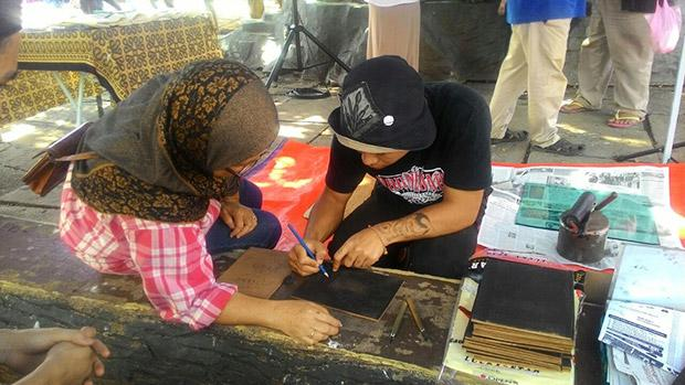 Pangrok Sulap visits 'tamus' around Sabah to share their love for art. — Picture courtesy of Rizo Leong