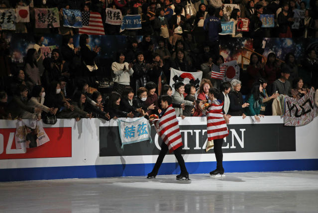 Nathan Chen from the U.S., left, and compatriot Vincent Zhou acknowledge the crowd after winning the gold and bronze medals respectively for the men's free skating routine during the ISU World Figure Skating Championships at Saitama Super Arena in Saitama, north of Tokyo, Saturday, March 23, 2019. (AP Photo/Andy Wong)