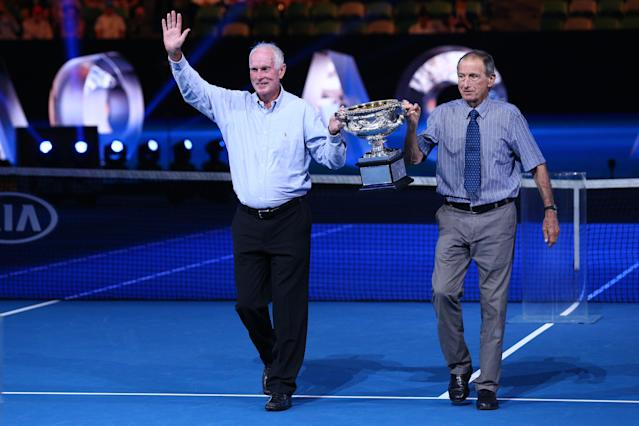 Former champions Bill Bowrey, left and Ashley Cooper, right, present the Norman Brookes Challenge Cup on the 50th and 60th anniversaries, respectively, of their Australian Open wins on Day 14 of the 2018 Australian Open. (Michael Dodge/Getty Images)