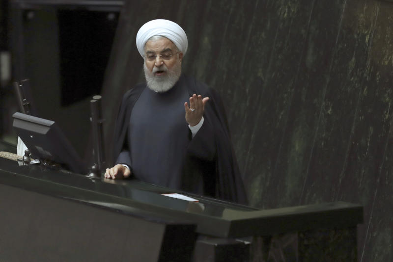 Iranian President Hassan Rouhani speaks while submitting next year's budget bill to the parliament in Tehran, Iran, Sunday, Dec. 8, 2019. Rouhani said his country will depend less on oil revenue next year, in a new budget that is designed to resist crippling U.S. trade embargoes. (AP Photo/Vahid Salemi)