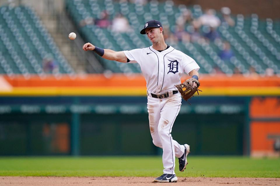 Detroit Tigers shortstop Zack Short throws to first during the fourth inning of the first baseball game of a doubleheader against the Minnesota Twins, Saturday, July 17, 2021, in Detroit. (AP Photo/Carlos Osorio)