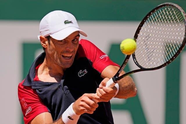 Pablo Andujar hits a backhand during his famous win