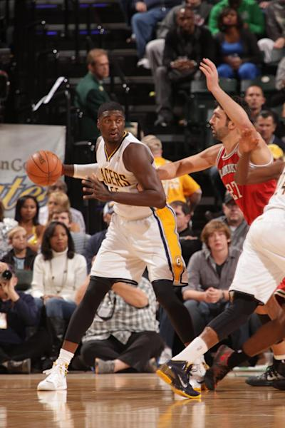 INDIANAPOLIS - NOVEMBER 15: Roy Hibbert #55 of the Indiana Pacers looks to pass the ball against the Milwaukee Bucks at Bankers Life Fieldhouse on November 15, 2013 in Indianapolis, Indiana. (Photo by Ron Hoskins/NBAE via Getty Images)