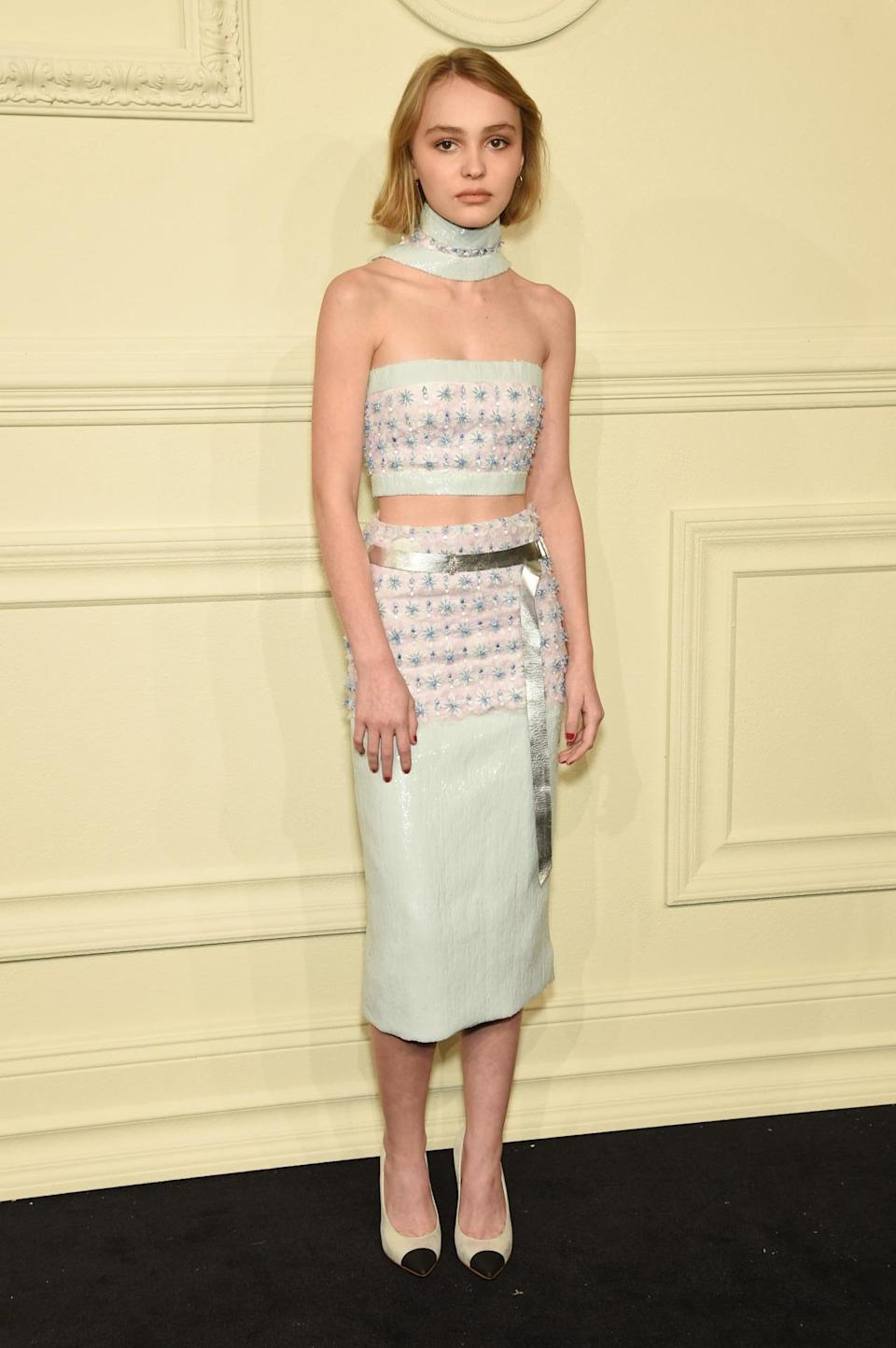 <p>Lily-Rose Depp, the 15-year-old daughter of Johnny Depp and Vanessa Paradis, made her fashion show debut in an embellished midriff-baring top and pencil skirt by Chanel. She attended the show with her mother and younger brother, Jack.</p>