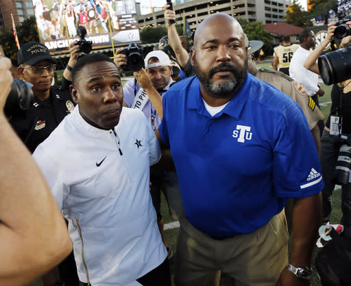 Vanderbilt head coach Derek Mason (L) and Tennessee State head coach Rod Reed meet on the field after an NCAA college football game Saturday, Sept. 29, 2018, in Nashville, Tenn. Vanderbilt won 31-27. (AP Photo/Mark Humphrey)