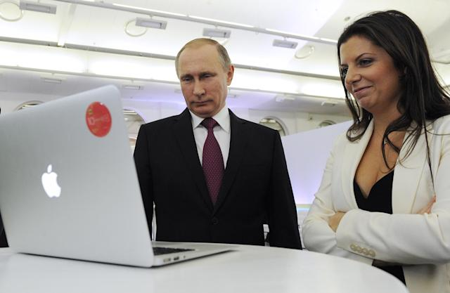 Russian President Vladimir Putin and RT editor in chief Margarita Simonyan attend a multimedia exhibition marking the 10th anniversary of the RT TV Channel in 2015. (Photo: Klimentyev Mikhail/TASS via ZUMA Press)