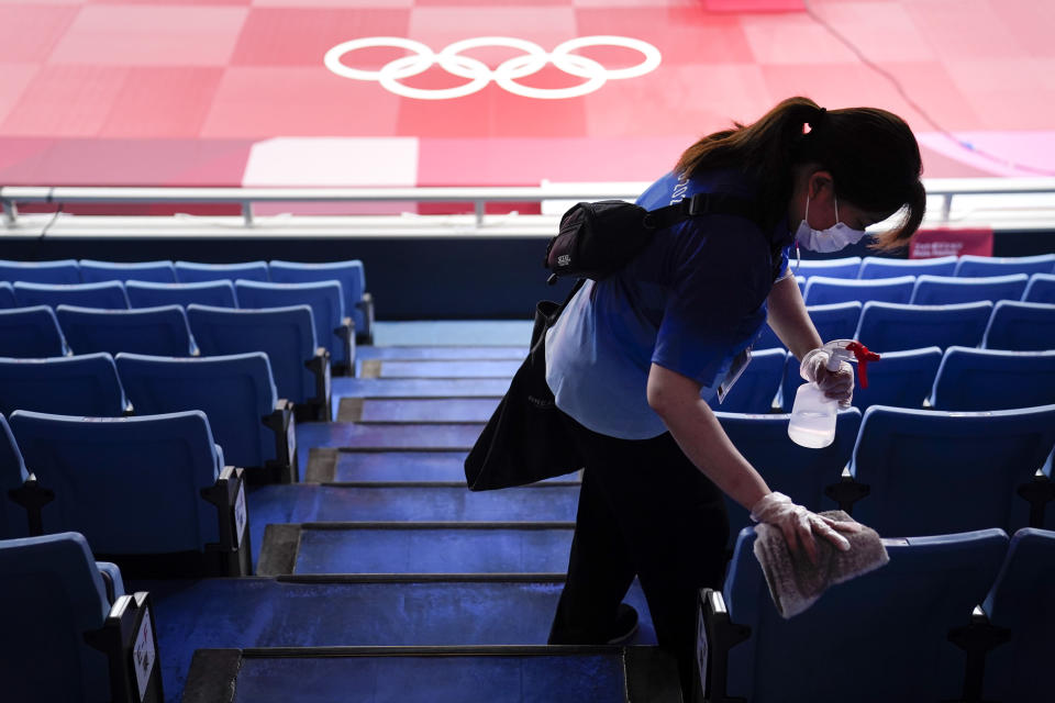 FILE - In this July 24, 2021, file photo, worker disinfects the seats before judo matches at the 2020 Summer Olympics in Tokyo, Japan. (AP Photo/Jae C. Hong, File)