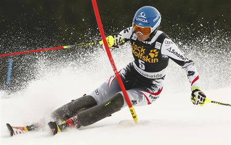 Marlies Schild of Austria clears a pole during the first run of the women's slalom at the FIS Alpine Skiing World Cup Finals in Lenzerheide March 15, 2014. REUTERS/Ruben Sprich