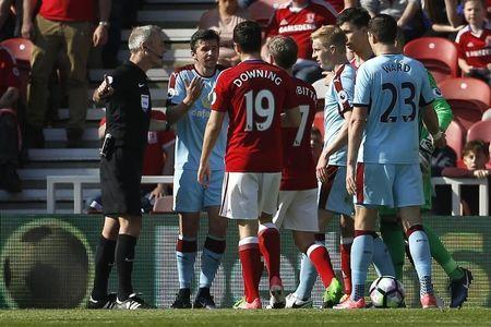 Britain Football Soccer - Middlesbrough v Burnley - Premier League - The Riverside Stadium - 8/4/17 Referee Martin Atkinson with Burnley's Joey Barton Action Images via Reuters / Craig Brough Livepic