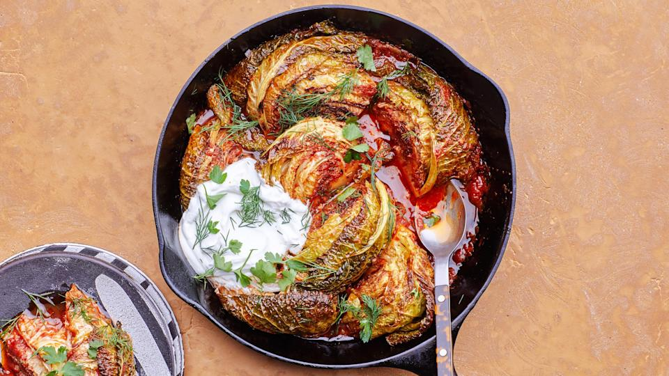 """Your cozy, vegetarian Passover feast should feature this super-tender cabbage, cooked in a spiced tomato broth. <a href=""""https://www.epicurious.com/recipes/food/views/fall-apart-caramelized-cabbage?mbid=synd_yahoo_rss"""" rel=""""nofollow noopener"""" target=""""_blank"""" data-ylk=""""slk:See recipe."""" class=""""link rapid-noclick-resp"""">See recipe.</a>"""