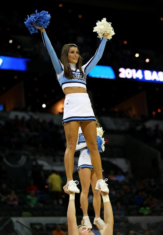 SAN ANTONIO, TX - MARCH 21: Cheerleaders from the North Carolina Tar Heels perform before the start the Tar Heels game against the Providence Friars in the second round of the 2014 NCAA Men's Basketball Tournament at AT&T Center on March 21, 2014 in San Antonio, Texas. (Photo by Ronald Martinez/Getty Images)