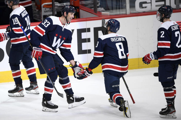 Washington Capitals defenseman Zdeno Chara (33), left-wing Alex Ovechkin (8), and defenseman Justin Schultz (2) react after an NHL hockey game against the New Jersey Devils, Sunday, Feb. 21, 2021, in Washington. (AP Photo/Nick Wass)