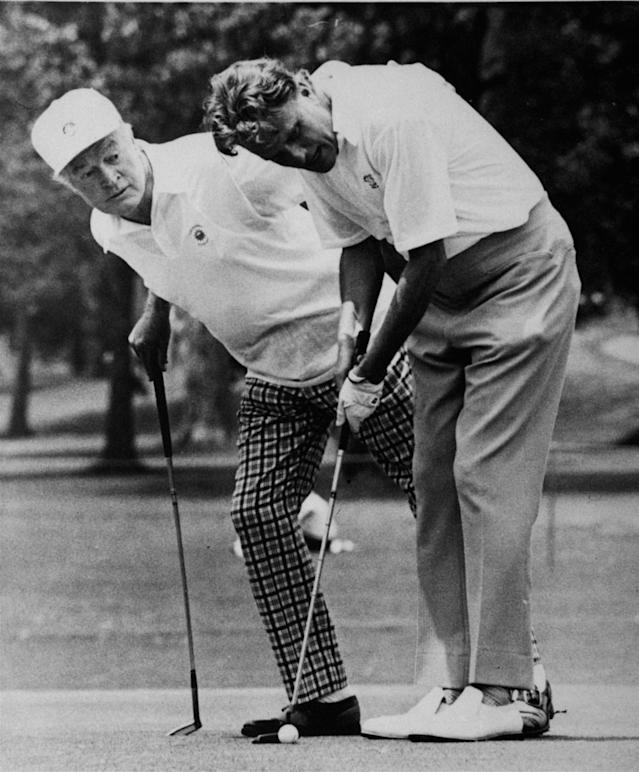 <p>Comedian Bob Hope, left, watches Billy Graham line up a putt during the Pro-Am play of the Byron Nelson Golf Classic in Dallas, May 6, 1971. (Photo: AP) </p>