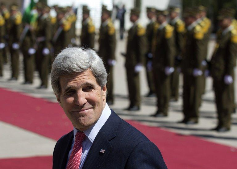 US Secretary of State John Kerry attends a ceremony in the West Bank city of Ramallah, on March 21, 2013