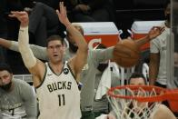 Milwaukee Bucks' Brook Lopez makes a three-point basket during the first half of Game 2 of the NBA Eastern Conference basketball finals game against the Atlanta Hawks Friday, June 25, 2021, in Milwaukee. (AP Photo/Morry Gash)