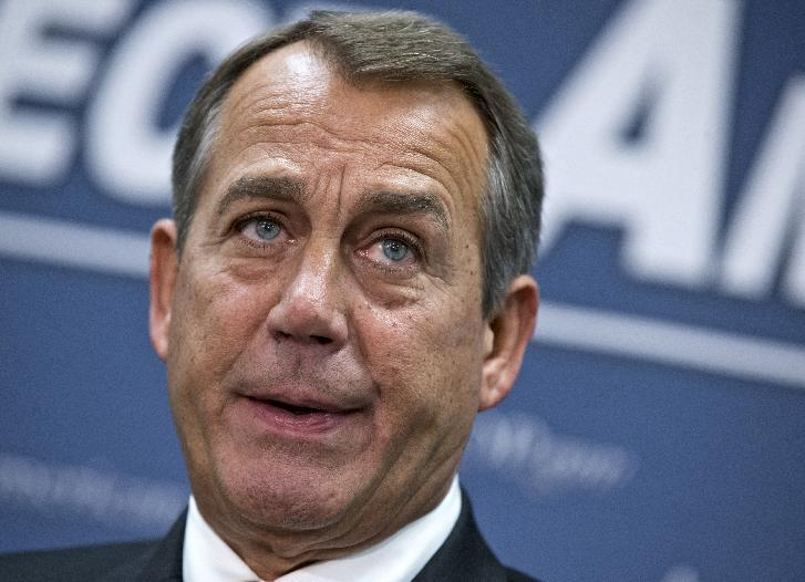 """House Speaker John Boehner of Ohio, who conferred with President Barack Obama by phone yesterday, speaks during a news conference on Capitol Hill in Washington, Wednesday, Dec. 12, 2012,  following a closed-door meeting with the GOP caucu. Boehner and the other House Republican leaders are calling for Obama to come up with plan they can accept for spending cuts and tax revenue to avoid the so-called """"fiscal cliff"""" of automatic tax hikes and budget reductions. (AP Photo/J. Scott Applewhite)"""