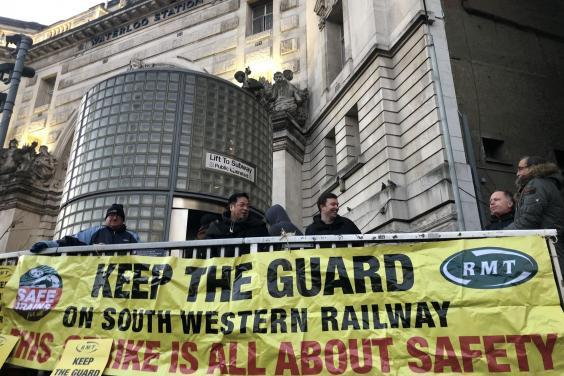 Line men: RMT union pickets outside Waterloo station in central London (Simon Calder)