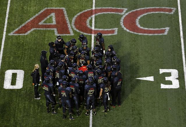 Members of the Maryland football team huddle in the first half of an NCAA college football game against Boston College in College Park, Md., Saturday, Nov. 23, 2013, its final home game in the Atlantic Coast Conference. Maryland moves to the Big Ten Conference next season. (AP Photo/Patrick Semansky)