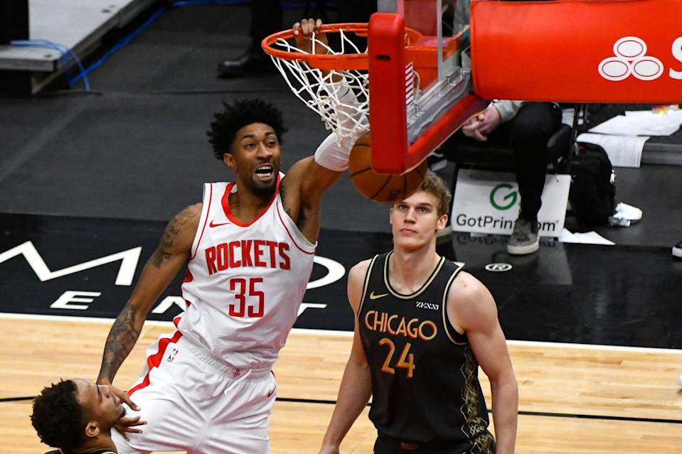 Houston Rockets center Christian Wood dunks past Chicago Bulls forward Lauri Markkanen (24) on Jan. 18, 2021, in Chicago.