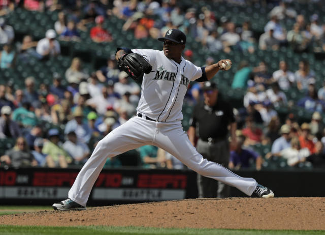 Seattle Mariners closing pitcher Roenis Elias throws against the Texas Rangers during the ninth inning of a baseball game, Wednesday, July 24, 2019, in Seattle. Elias earned the save and the Mariners won 5-3. (AP Photo/Ted S. Warren)