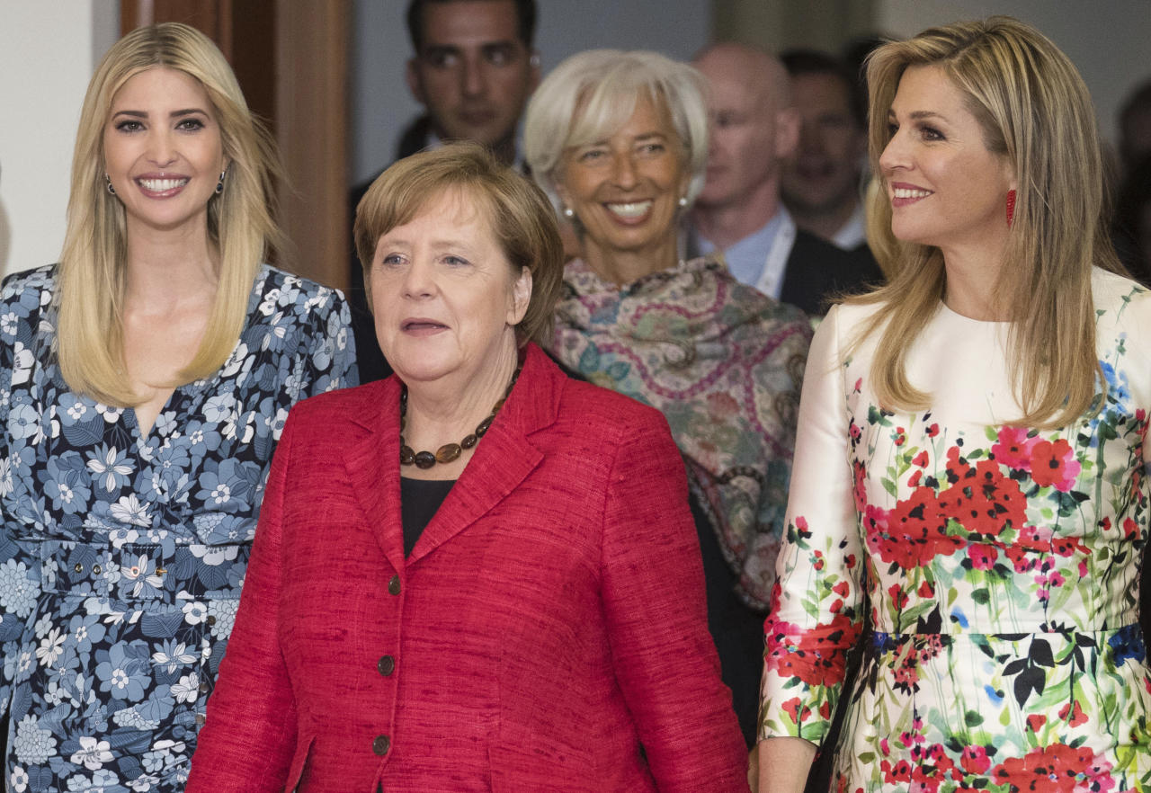 Ivanka Trump, daughter and adviser of U.S. President Donald Trump, left, arrives with Queen Maxima of the Netherlands, right, German Chancellor Angela Merkel, center, and Christine Lagarde, Managing Director of the International Monetary Fund, at the Woman 20 Dialogue summit for the empowerment of women in Berlin, Germany, Tuesday, April 25, 2017. (Michael Kappeler/dpa via AP)