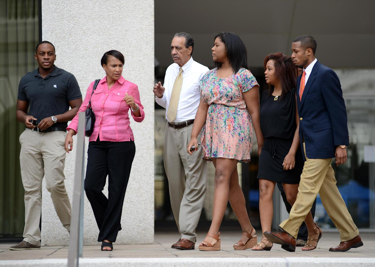 Family members of former New Orleans Mayor Ray Nagin, including his father Clarence Ray Nagin, Sr., center, leave federal court after the former mayor's sentencing in New Orleans, Wednesday, July 9, 2014. Nagin was sentenced Wednesday to 10 years in prison for bribery, money laundering and other corruption that spanned his two terms as mayor, including the chaotic years after Hurricane Katrina hit in 2005. (AP Photo/Andrea Mabry)