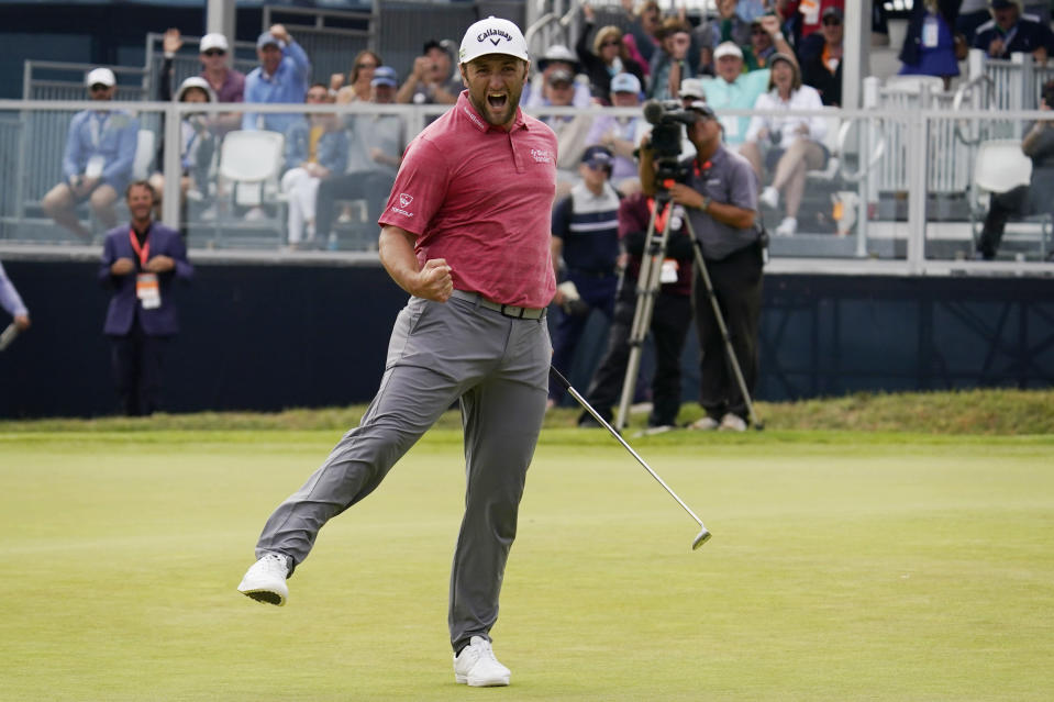 Jon Rahm, of Spain, reacts to making his birdie putt on the 18th green during the final round of the U.S. Open Golf Championship, Sunday, June 20, 2021, at Torrey Pines Golf Course in San Diego. (AP Photo/Gregory Bull)