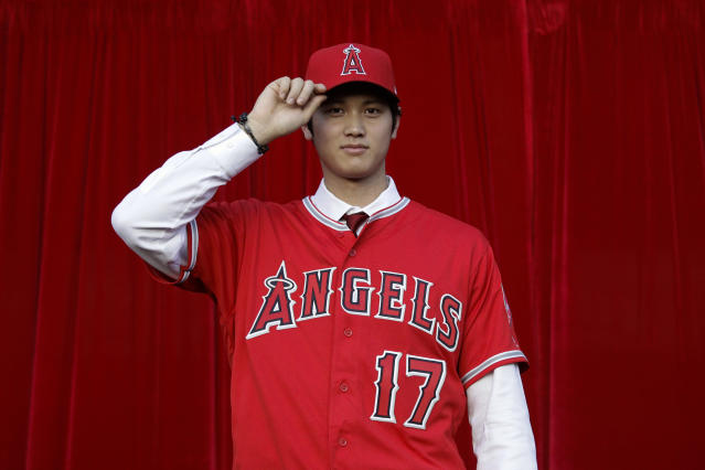Shohei Ohtani is bringing his arm and bat to the Los Angeles Angels, pairing him with two-time MVP Mike Trout. (AP)