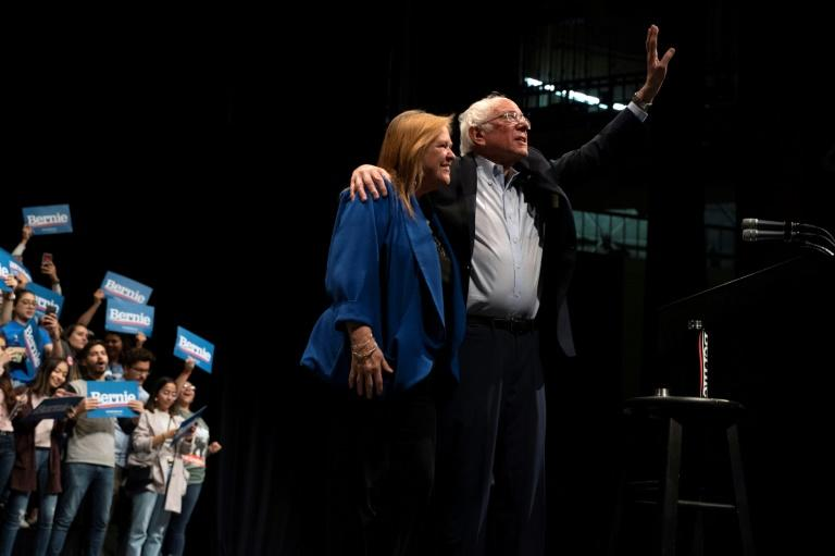 Democratic presidential hopeful Bernie Sanders waves as he leaves the stage with his wife Jane Sanders after speaking during a rally in El Paso, Texas on February 22, 2020