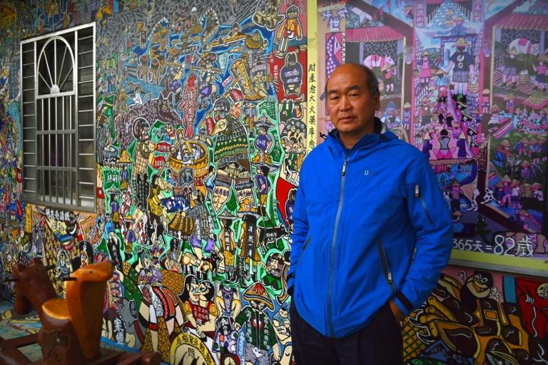 Nestled in the mist-covered foothills of Taiwan's central mountain range, Ruan Chiao village is virtually devoid of young people, but artist Wu Tsun-hsien is coaxing the Instagram generation back by transforming local homes into a canvas of colour (AFP Photo/Sam YEH)