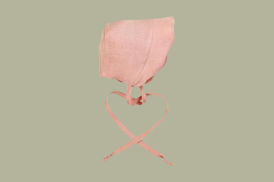"""<p>What could be more charming than a baby's bonnet? With a tie at the neck and scalloped ruffle trim, its sweet details are finely made by skilled craftspeople in North Texas.</p> <p><strong><em>Shop Now:</em></strong><em> Little Goodall Linen Scallop Bonnet in Shell Pink, $33, <a href=""""https://www.littlegoodall.com/collections/bonnet-shop/products/linen-scallop-bonnet-in-shell-pink"""" rel=""""nofollow noopener"""" target=""""_blank"""" data-ylk=""""slk:littlegoodall.com"""" class=""""link rapid-noclick-resp"""">littlegoodall.com</a></em><em>.</em></p>"""