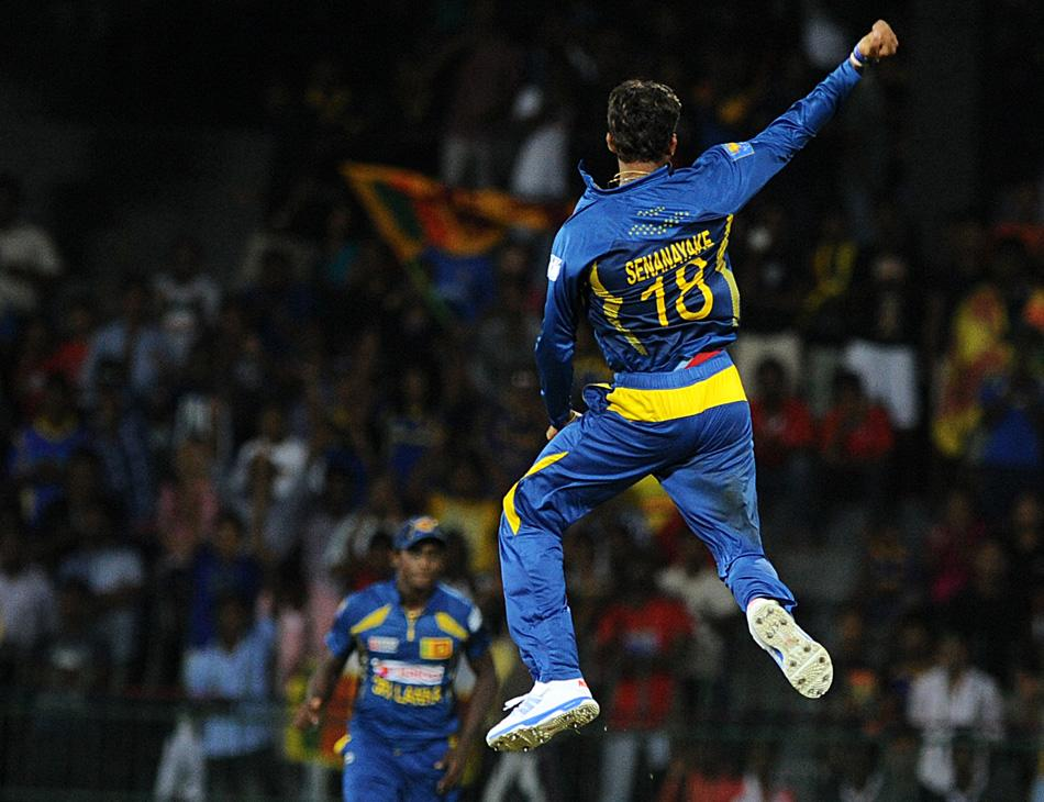 Sri Lankan spinner Sachithra Senanayake celebrates after he dismissed South African batsman Faf du Plessis during the first Twenty20 cricket match between Sri Lanka and South Africa at the R. Premadasa Stadium in Colombo on August 2, 2013. AFP PHOTO/Ishara S. KODIKARA        (Photo credit should read Ishara S. KODIKARA/AFP/Getty Images)