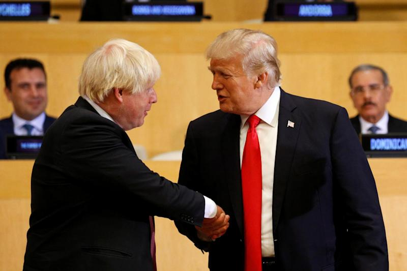 U.S. President Donald Trump shakes hands with British Foreign Secretary Boris Johnson as they meet at the United Nations (REUTERS)
