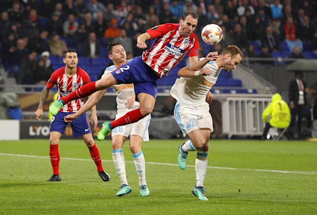 Soccer Football - Europa League Final - Olympique de Marseille vs Atletico Madrid - Groupama Stadium, Lyon, France - May 16, 2018 Atletico Madrid's Diego Godin in action with Marseille's Valere Germain REUTERS/John Sibley