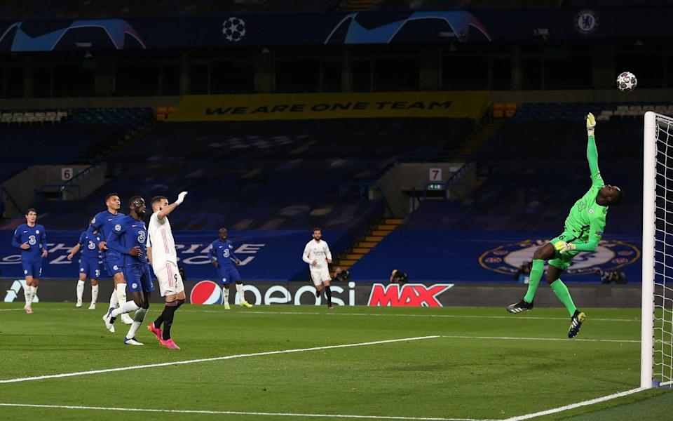 Edouard Mendy of Chelsea makes a save from Karim Benzema of Real Madrid during the UEFA Champions League Semi Final Second Leg match between Chelsea and Real Madrid at Stamford Bridge on May 05, 2021 in London, England. Sporting stadiums around Europe remain under strict restrictions due to the Coronavirus Pandemic as Government social distancing laws prohibit fans inside venues resulting in games being played behind closed doors - Steve Bardens - UEFA/UEFA via Getty Image